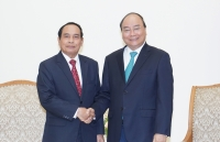 pm nguyen xuan phuc vietnam ready to partner with laos in inspection work