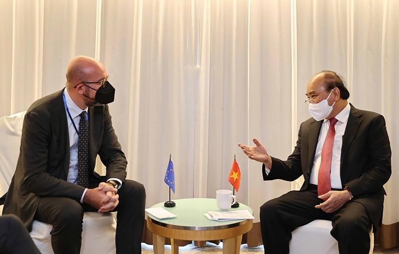 Chủ tịch nước Nguyễn Xuân Phúc gặp Chủ tịch Hội đồng Châu Âu Charles Michel. (Nguồn: TTXVN)