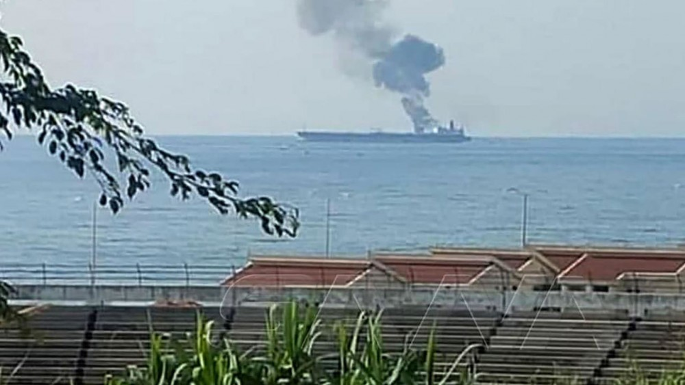 A handout picture released by the official Syrian Arab News Agency (SANA) on April 24, 2021 shows smoke billowing from a tanker off the coast of the western Syrian city of Banias - SANA/AFP