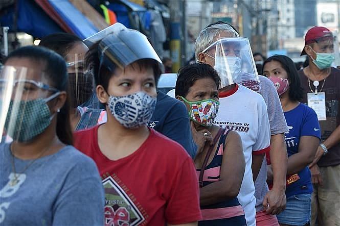 Tin tức ASEAN buổi sáng 20/11: Covid-19 chưa 'hạ nhiệt' tại ASEAN; Việt Nam được đánh giá là câu chuyện kinh tế thành công nhất